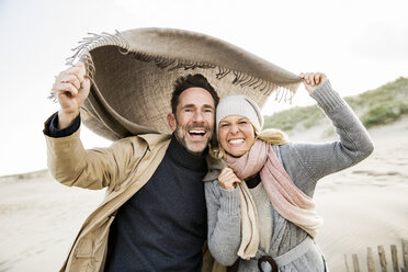 Portrait of happy couple on beach - FMKF04274