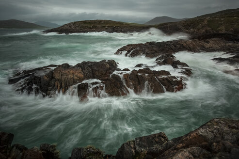 UK, Scotland, Isle of Lewis, cliff on stormy day, long exposure - FCF01227