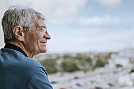 Smiling senior man with hearing aid outdoors - ZEDF00752