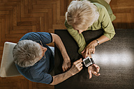 Senior couple taking blood pressure - ZEDF00755