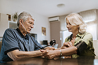 Senior couple taking blood pressure - ZEDF00764