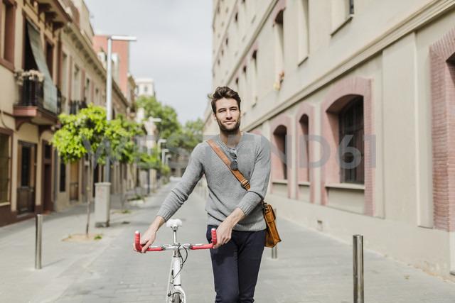 Young man pushing his bike - GIOF02961