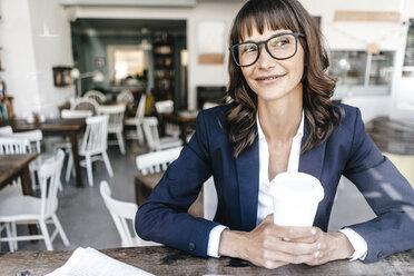Woman in cafe, drinking coffee - KNSF01908