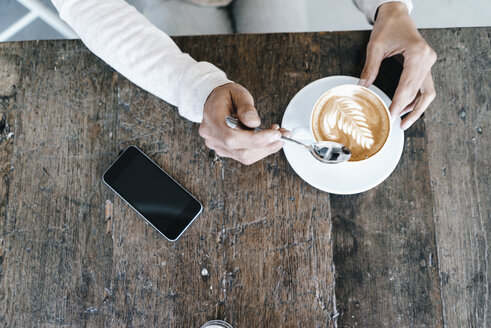 Woman in cafe, drinking coffee - KNSF01920