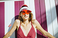 Portrait of young woman with bikini and sun visor - KIJF01651