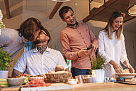 Friends preparing food together at home - GUSF00072