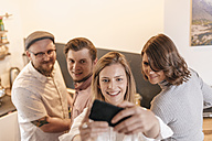 Friends taking selfie with smartphone at home - GUSF00084