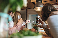 Friends taking selfie with tablet at home - GUSF00087