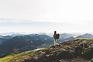 Austria, Salzkammergut, Hiker with backpack hiking in the Alps - UUF10980