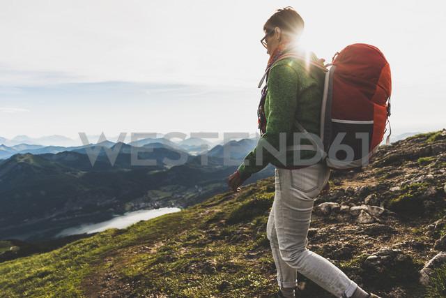 Austria, Salzkammergut, Hiker with backpack hiking in the Alps - UUF10983