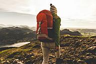 Austria, Salzkammergut, Hiker with backpack hiking in the Alps - UUF10986