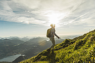 Austria, Salzkammergut, Hiker walking alone in the mountains - UUF10995