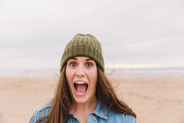 Portrait of woman pulling funny face on the beach - NMSF00133