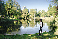 Businesswoman relaxing in the park - KNSF02023