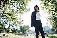 Businesswoman relaxing in the park - KNSF02029