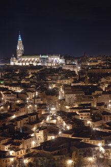 Spain, Toledo, view to lighted cathedral and cityscape at night - DHCF00090