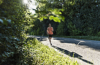 Young man running in the park - UUF11106