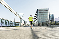 Young athlete jogging in the city - UUF11109