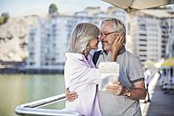 Senior couple taking a city break, holding map - ZEF14148