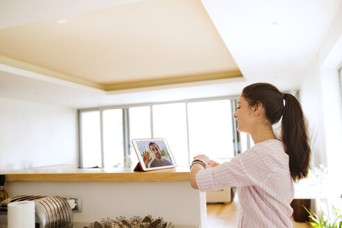 Young woman using tablet for video chat at home - HAPF01888