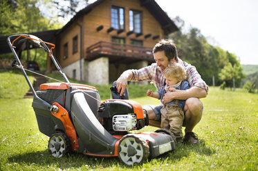 Father with his little son and lawn mower - HAPF01994