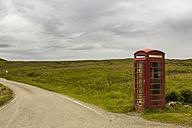UK, Scotland, Isle of Skye, red old telephone booth at roadside - FCF01243