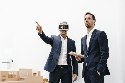 Two businessmen with VR glasses and architectural model - KNSF02164