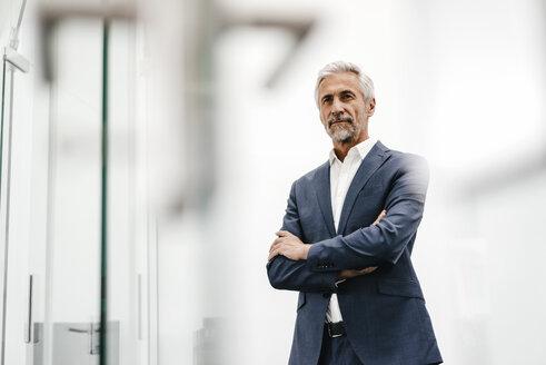 Portrait of confident mature businessman in office - KNSF02200