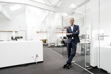 Portrait of confident mature businessman in office - KNSF02221