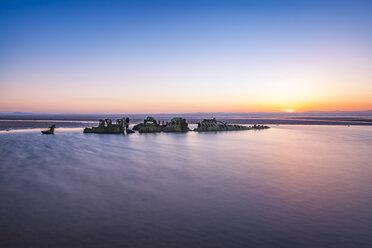 UK, Scotland, Aberlady, coast with submarine wreck at sunset - SMAF00793