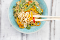 Chopsticks with mie noodles, chili pod and bell pepper, close-up - LVF06232