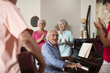 Elderly people making music in retirement home - ZEF14240