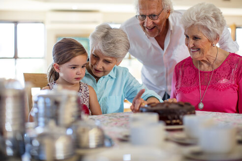 Grandparents celebrating a birthday with their granddaughter - ZEF14246