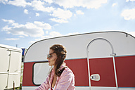 Young woman standing in front of food truck - SUF00243