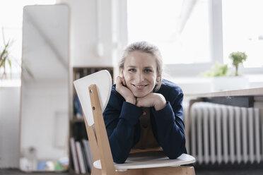 Portrait of smiling businesswoman in a loft - KNSF02238
