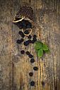 Wickerbasket of organic blackberries and leaves on wood - LVF06237