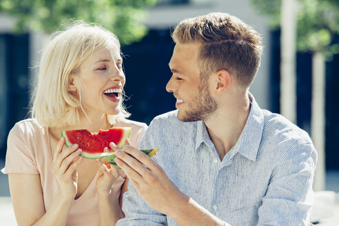 Happy couple eating watermelon together - CHAF01928