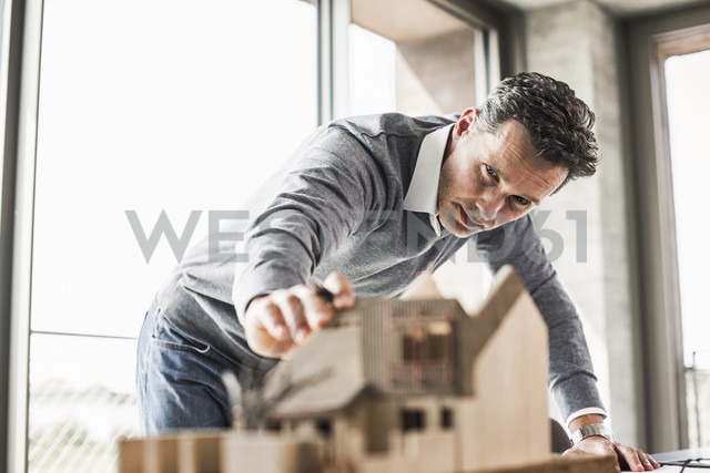 Architect working on architectural model - UUF11249
