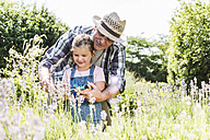 Grandfather and granddaughter in lavender field - UUF11327