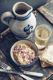 Glass and jar of Hessian cider and bowl of hand cheese - IPF00404