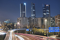 Spain, Madrid, financial district by night and rays of traffic lights - DHCF00117