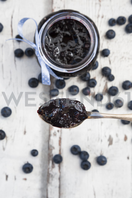 Spoon and glass of blueberry jam and blueberries - LVF06250