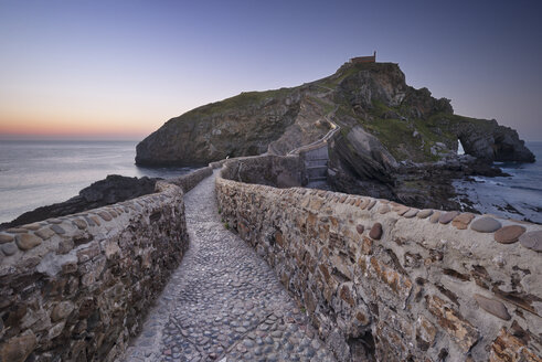Spain, Basque Country, San Juan de Gaztelugatxe hermitage at dusk - DHCF00122