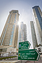 United Arab Emirates, Dubai, Direction Sign in front of the high rises of Dubai Marina - NKF00476