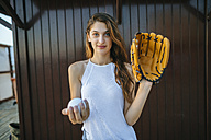 Portrait of young woman with baseball and baseball glove - KIJF01689