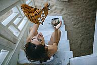 Young woman playing with baseball glove - KIJF01695