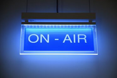 Lighted blue sign 'on air' - AXF00799