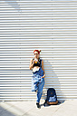 Young woman with soft drink and backpack - FMOF00300