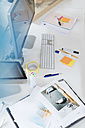 Desk with photo and documents in office - FKF02493