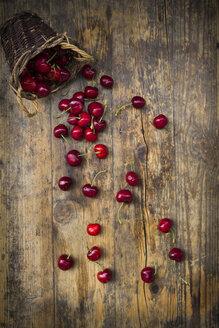 Wickerbasket of cherries on wood - LVF06257